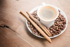 Cup of coffee with cinnamon and beans Royalty Free Stock Images