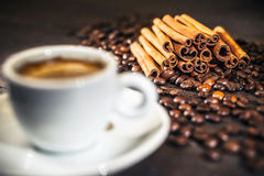 Cup of coffee with cinnamon and beans. Stock Photo