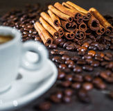 Cup of coffee with cinnamon and beans. Royalty Free Stock Photo