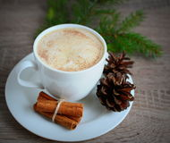 Cup of coffee with cinnamon and brown pine cones Stock Photo