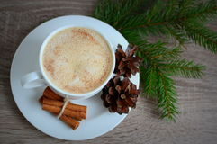 Cup of coffee with cinnamon and brown pine cones Royalty Free Stock Images