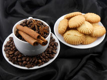 Cup of coffee with cinnamon, cake and coffee beans Royalty Free Stock Photography