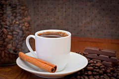 Cup of coffee, cinnamon and chocolate Stock Images