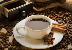 Cup of coffee with cinnamon and coffee beans star anise Stock Photos