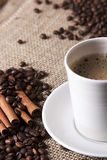 Cup of coffee with cinnamon and coffee grains. Fresh coffee with cinnamon and coffee grains Stock Photo