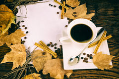 Cup of coffee and cinnamon royalty free stock photos