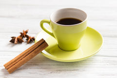 Cup of coffee with cinnamon. On the light background Stock Photo