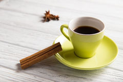 Cup of coffee with cinnamon. On the light background Royalty Free Stock Photos