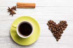 Cup of coffee with cinnamon. On the light background Stock Images