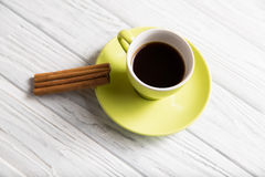 Cup of coffee with cinnamon. On the light background Stock Image