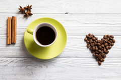 Cup of coffee with cinnamon. On the light background Royalty Free Stock Image