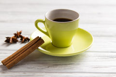 Cup of coffee with cinnamon. On the light background Stock Photos