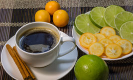 A cup of coffee with cinnamon and lime. A cup of fragrance coffee with cinnamon and lime royalty free stock photo