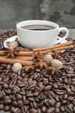 Cup of coffee with cinnamon, star anise, nutmeg and coffee beans Stock Photography