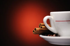 Cup of coffee with cinnamon sticks Stock Images