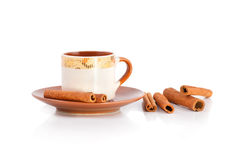 Cup of coffee and cinnamon sticks isolated on white background Stock Photography