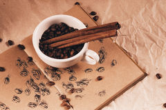 Cup of coffee with cinnamon sticks Stock Photography