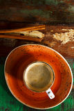 A cup of coffee with cinnamon sticks  on wood Stock Images