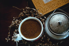 Cup of coffee with cinnamon. Still life with cup of coffee with cinnamon and a sugar-bowl Stock Photo