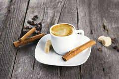 Cup of coffee with cinnamon and sugar on a dark wooden backgroun Royalty Free Stock Photography