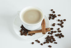 Cup of coffee with cinnamon Stock Images