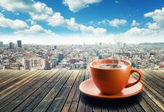 Cup of coffee on city background Royalty Free Stock Images