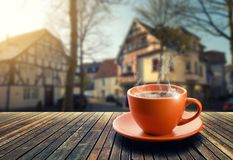Cup of coffee on city background Royalty Free Stock Photos