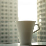 Cup of coffee with city scape background Royalty Free Stock Images