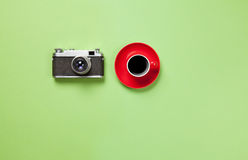 Cup of coffee and classic camera Stock Photos