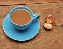 Cup of coffee and clock Royalty Free Stock Images
