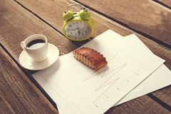 Cup of coffee and clock on document paper royalty free stock photo