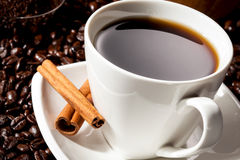 Cup of Coffee. Close-up of Black Coffee in a white Coffee cup with cinnamon and whole beans stock photography