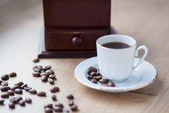 Cup of coffee close-up on a wooden background, coffee beans. Pleasant morning and cheerfulness. Mood stock image
