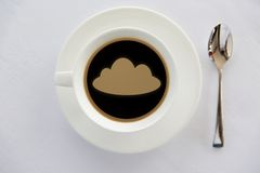 Cup of coffee with cloud silhouette and spoon Stock Photography