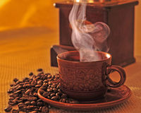 Cup of coffee with coffee bean royalty free stock images