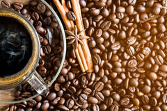 Cup of coffee and coffee bean Stock Images