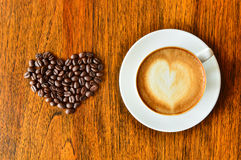A cup of coffee and coffee bean with heart shape Stock Images