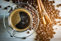 Cup of coffee and coffee bean Stock Photos