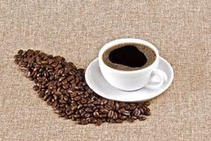 Cup of coffee and coffee beans Royalty Free Stock Photo
