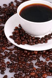 A cup of coffee and coffee beans Stock Photography