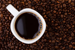 Cup of coffee on coffee beans. Royalty Free Stock Photo