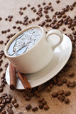 Cup of coffee and coffee beans. On sacking material Royalty Free Stock Photo