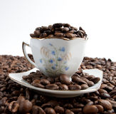 Cup of coffee with coffee beans Royalty Free Stock Photos