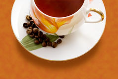 Cup of coffee and coffee beans Stock Photos