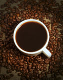 A cup of coffee and coffee beans Royalty Free Stock Photo