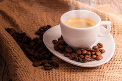 Cup of coffee with coffee beans stock photography