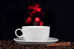 Cup of coffee with coffee beans Stock Images