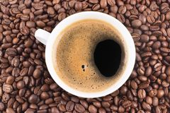 Cup of coffee and coffee-beans royalty free stock photography