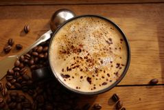 Cup of coffee and coffee beans stock image