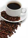 Cup of coffee with coffee beans. Close-up image of cup of coffee with coffee beans Royalty Free Stock Photos